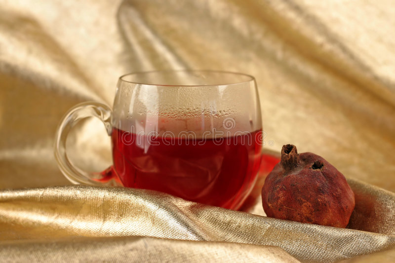 Cup of roibos fruit tea stock photography