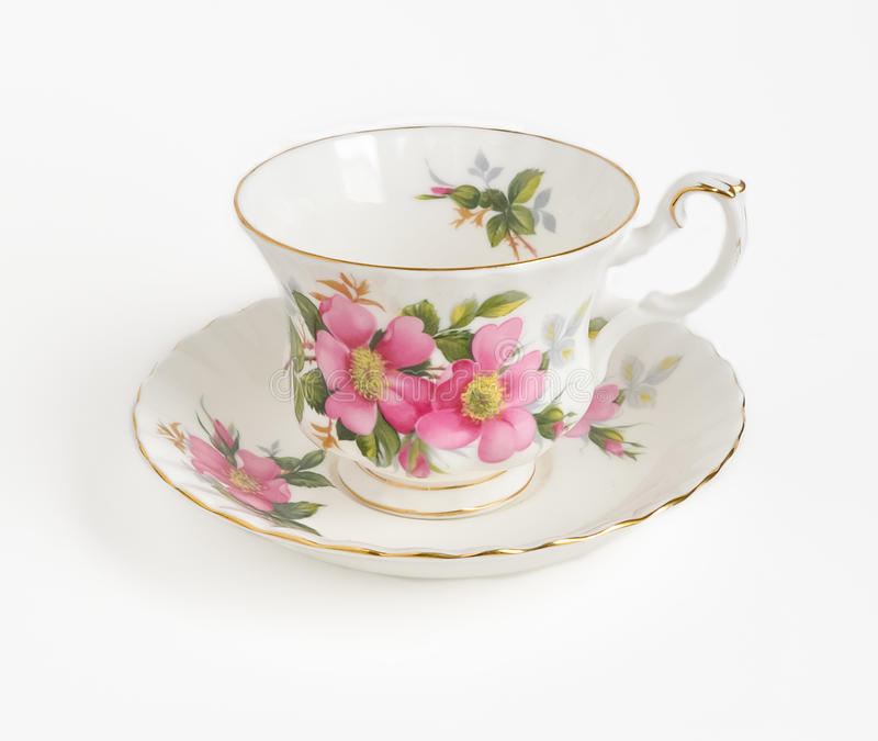 Cup and saucer. Porcelain cup and saucer on white background royalty free stock photography