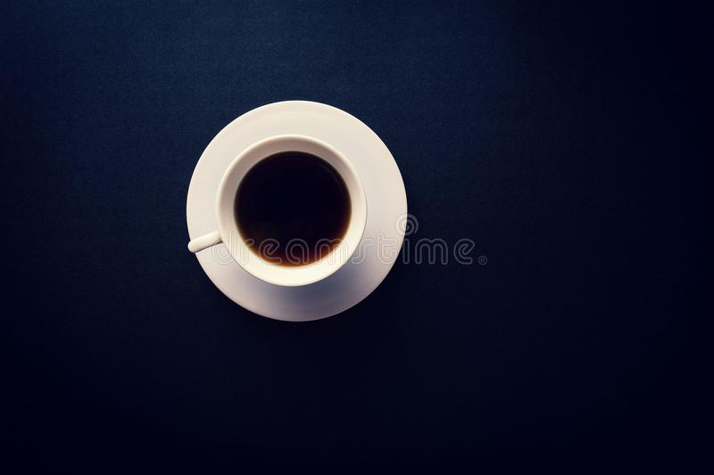 Cup and saucer on black stock photos