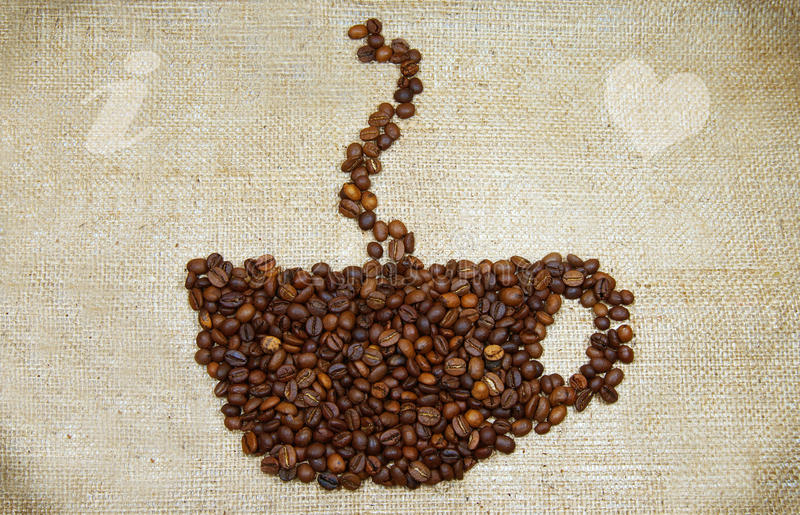 Cup-shaped pattern of coffee beans stock images