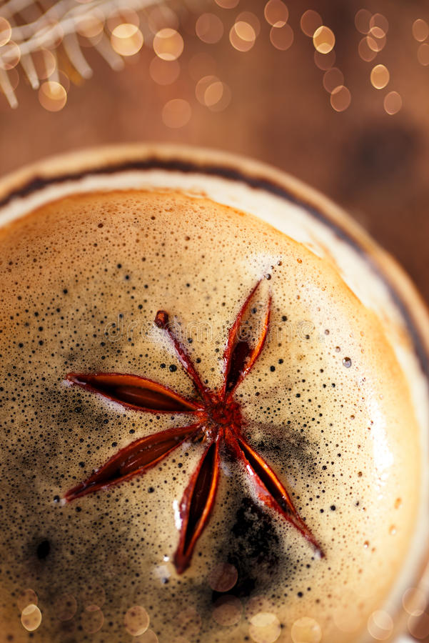 A cup of spiced coffee with anis star macro stock photography