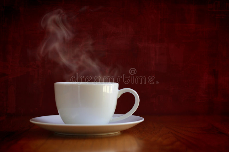 cup steaming white arkivfoton