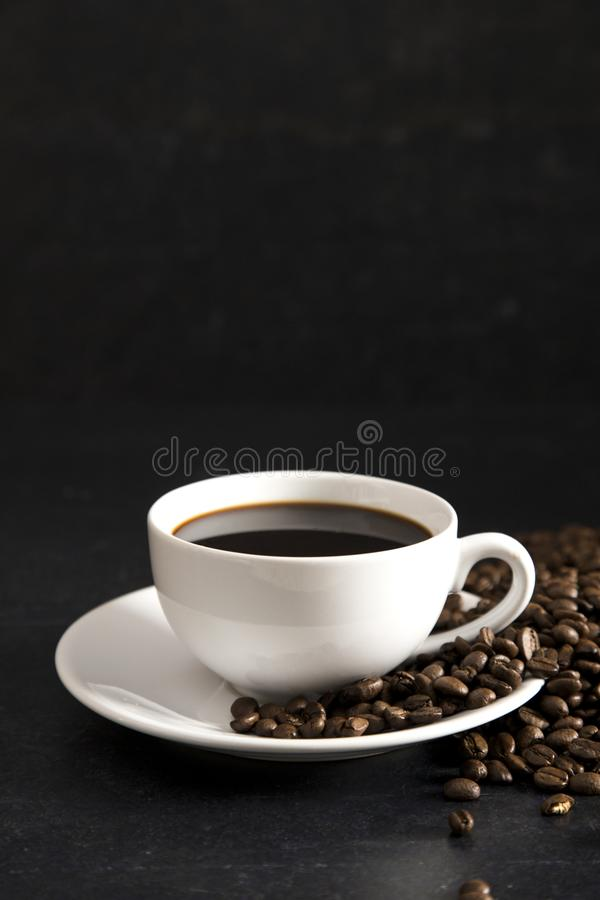 Cup of Strong Black Coffee. In a White Cup and Saucer stock photo