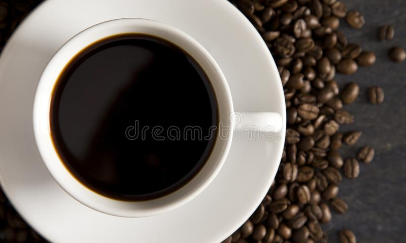 Cup of Strong Black Coffee. In a White Cup and Saucer royalty free stock photos