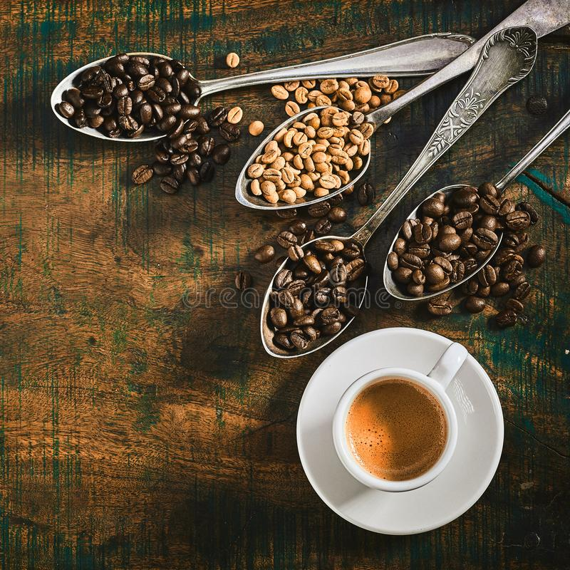 Cup of strong espresso coffee with roasted beans stock photos