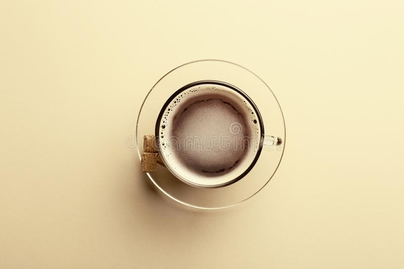 Cup with tasty aromatic coffee on color background, top view stock image