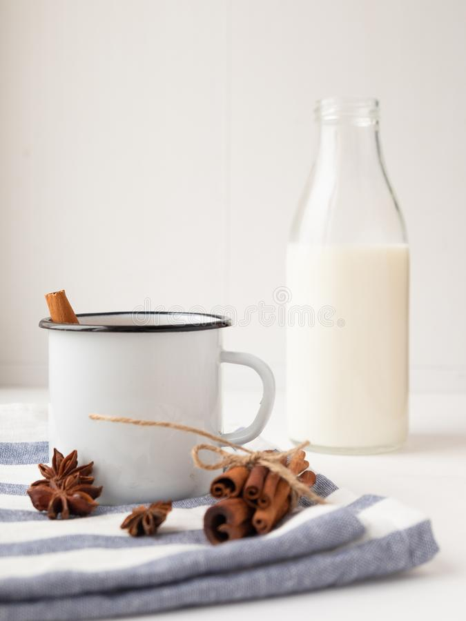 Cup with tasty chocolate milk on a wooden table. Milk drink stock photos