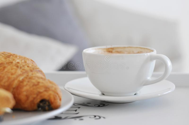 Cup of coffee and croissants stock image