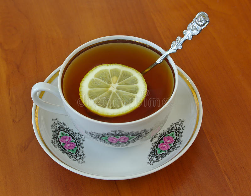 Download Cup of tea stock photo. Image of plate, saucer, yellow - 13467352