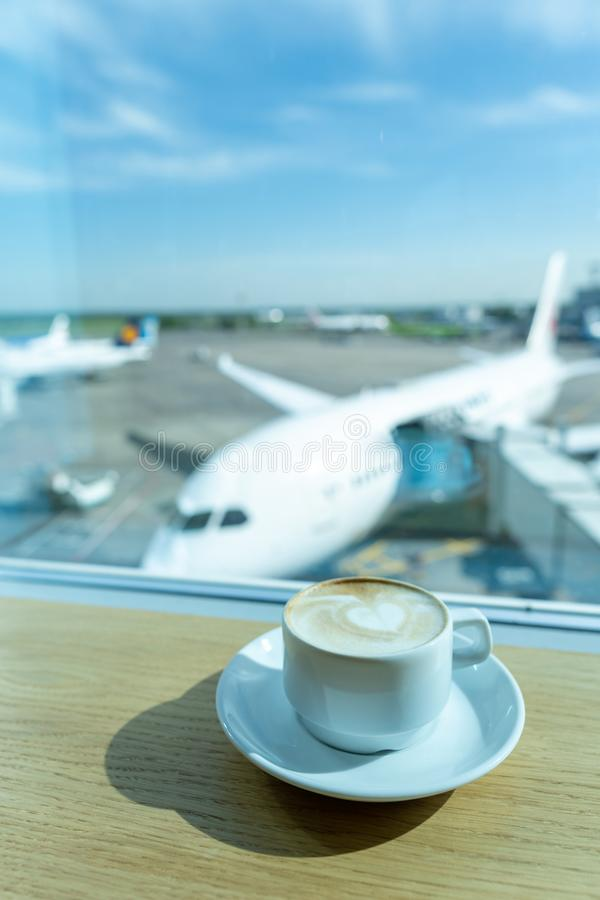 Cup of tea in airport`s business lounge. Waiting for the flight. Airplan on the backround stock photos