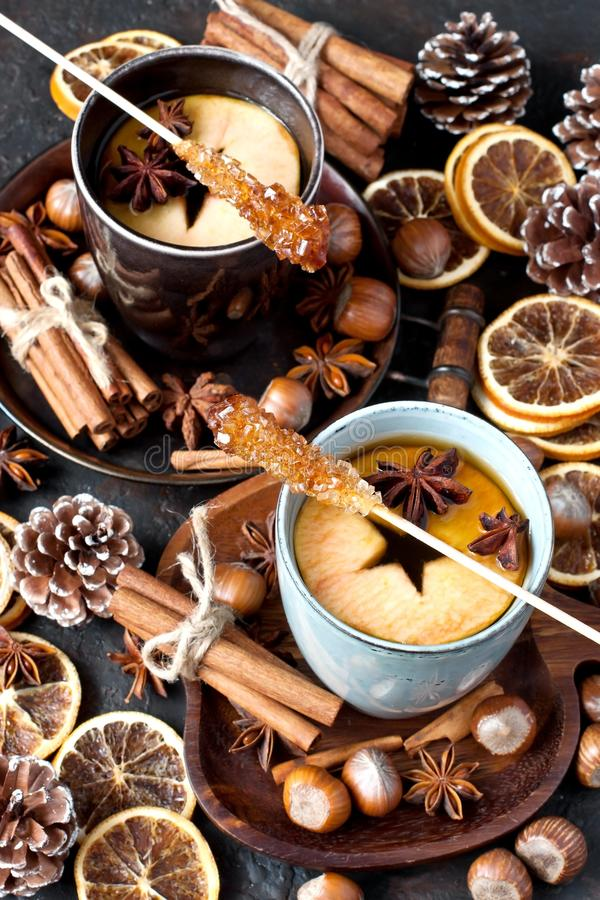 Cup of tea, apple, spices, nuts. Top view. Hot tea with apple and spices. Healthy drink. Hot winter beverage concept stock photo