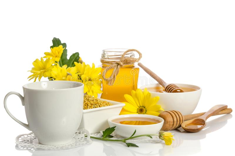 A cup of tea and bee products honey, pollen. On white background stock photography