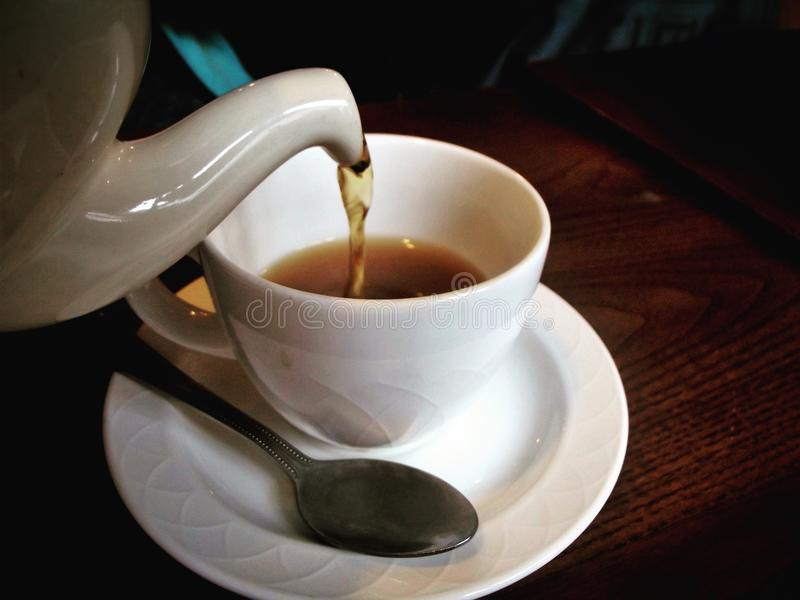 Cup of tea. Tea being poured into a teacup stock photos