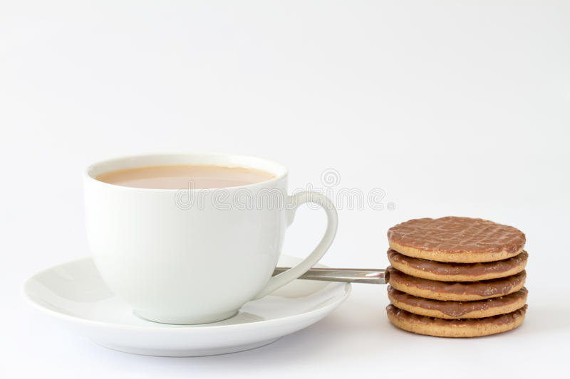 Cup of tea with biscuits. Cup of tea with chocolate biscuits stock photography