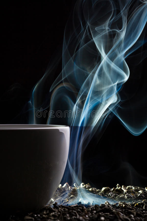 Cup of tea with blue smoke
