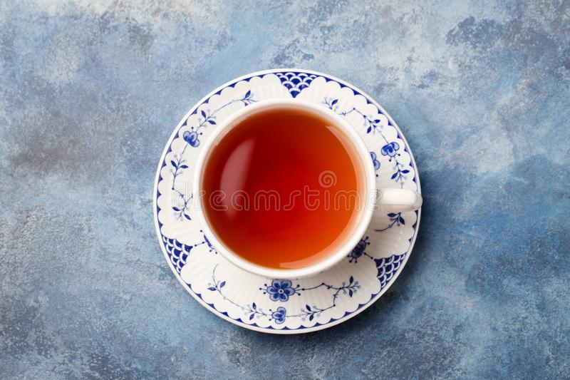 Cup of tea on a blue stone background. Copy space. Top view. royalty free stock image
