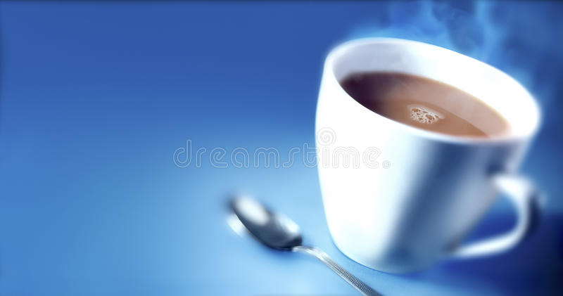 CUP OF TEA. A blurred shot of a hot cup of tea against a blue background stock images