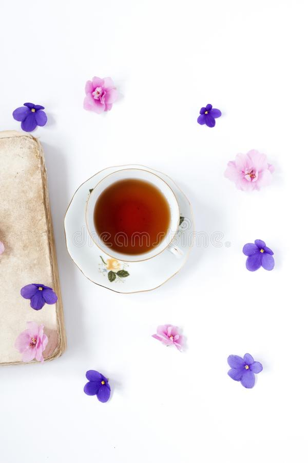 Cup of tea on book with flower over wite background . Cup of tea on book with flower over wite background stock photography