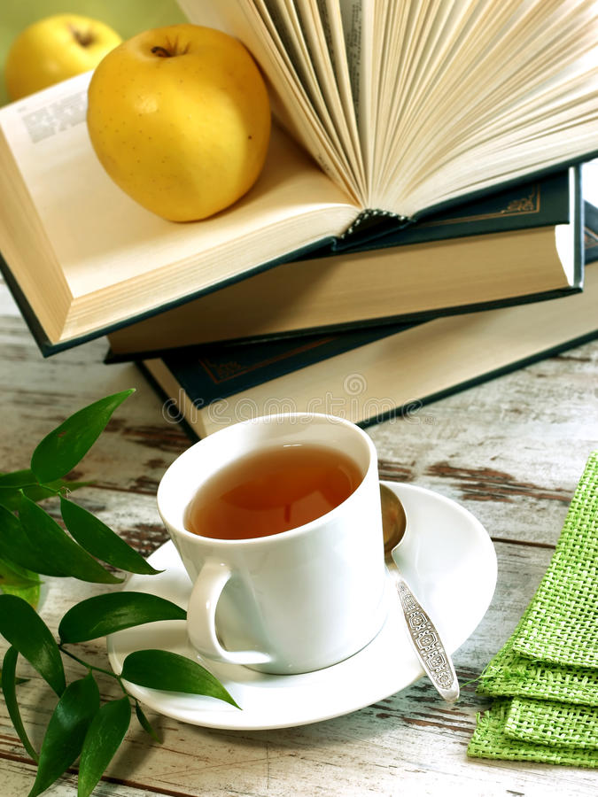 Download Cup Of Tea, Books And Apple On Wooden Stock Photo - Image: 13623314