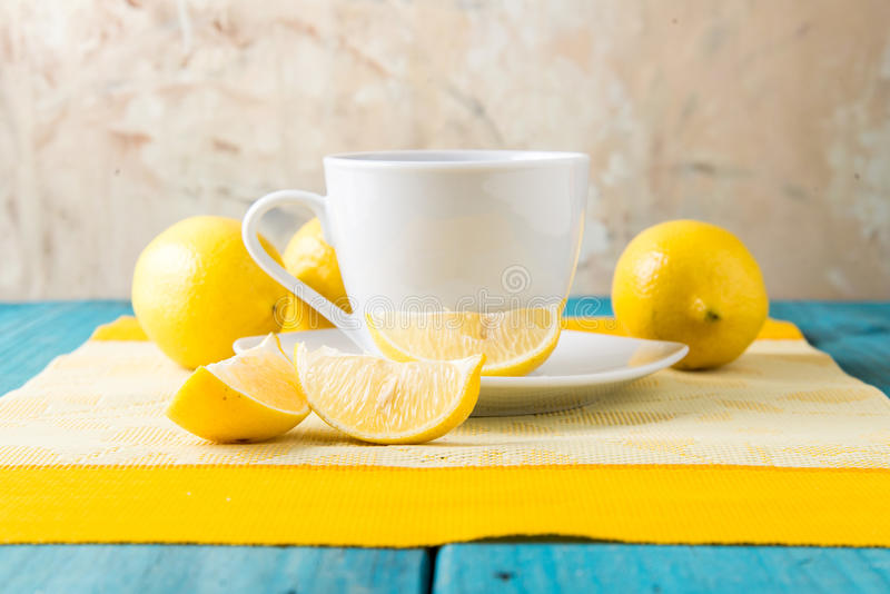 Cup of tea / coffee & lemons royalty free stock images