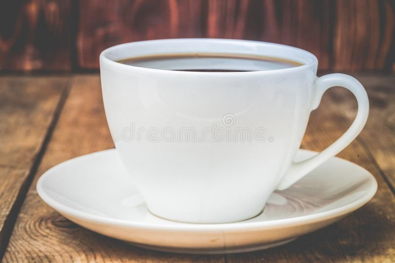 Cup of tea or coffeee. On wooden table. Toned photo stock image