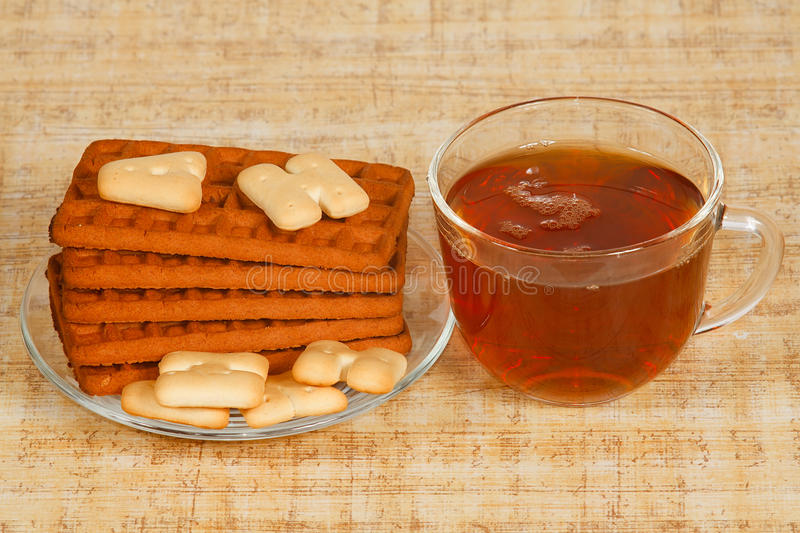 The cup of tea and cookies royalty free stock images
