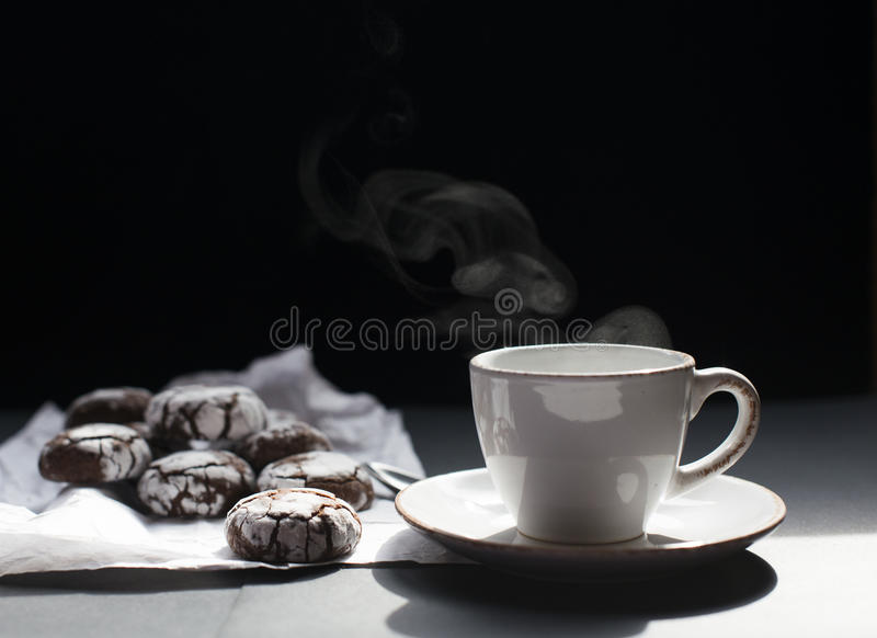 Cup of tea with cookies. Cup of tea or coffee with chocolate cookies. Dark background. white cup. Chocolate cookies royalty free stock photography