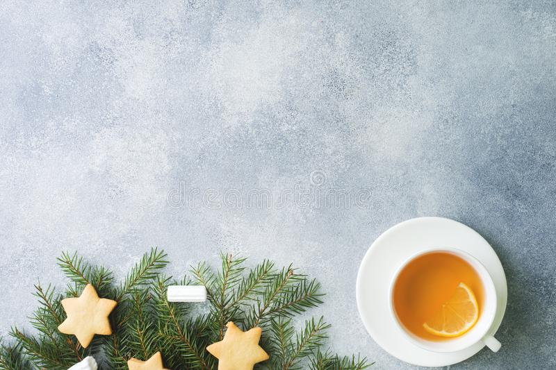 Cup of tea and cookies, pine branches, cinnamon sticks, anise stars. Christmas, winter concept. Flat lay top view royalty free stock images