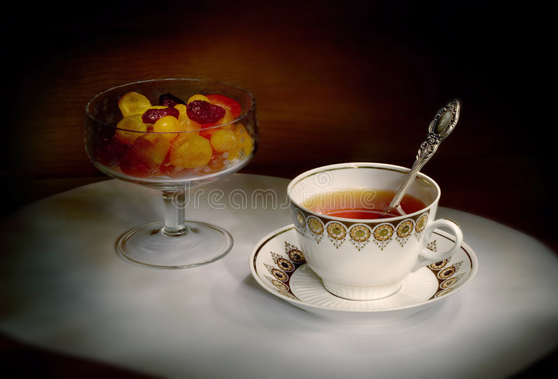 Cup of tea and dried fruits. Still-life with a cup of tea and dried fruits royalty free stock photography