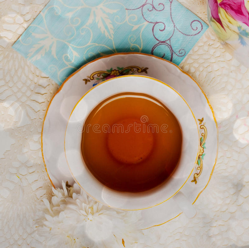 Cup of tea with flower royalty free stock photos
