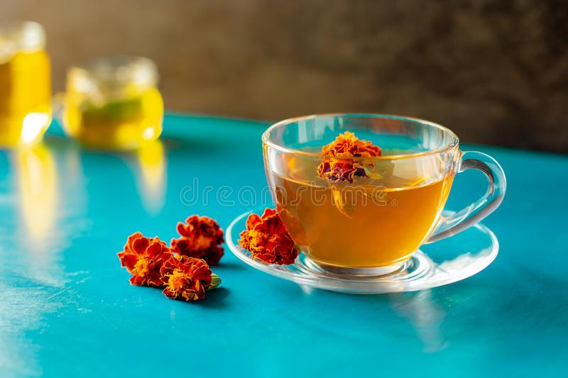 A cup of tea from the flowers of Chernobrivtsov. Processing of dried flowers marigolds. A cup of tea from the flowers of Calendula and Chernobrivtsov. Processing royalty free stock photo