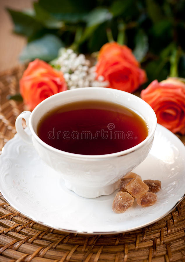 Cup of tea and flowers roses royalty free stock photos