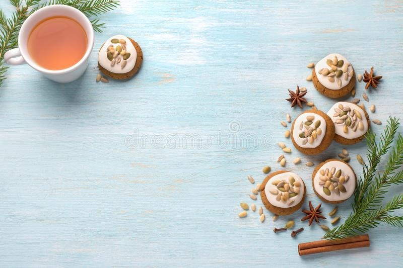 A cup of tea with fragrant honey Christmas gingerbreads with glaze and nuts stock images