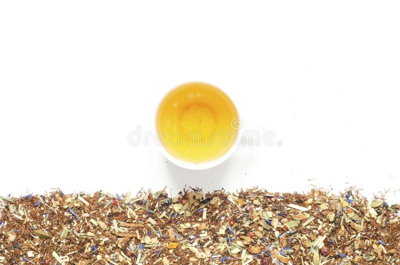 Cup of tea. Herbal tea, dry herbs and flowers with pieces of fruit and berries. stock image