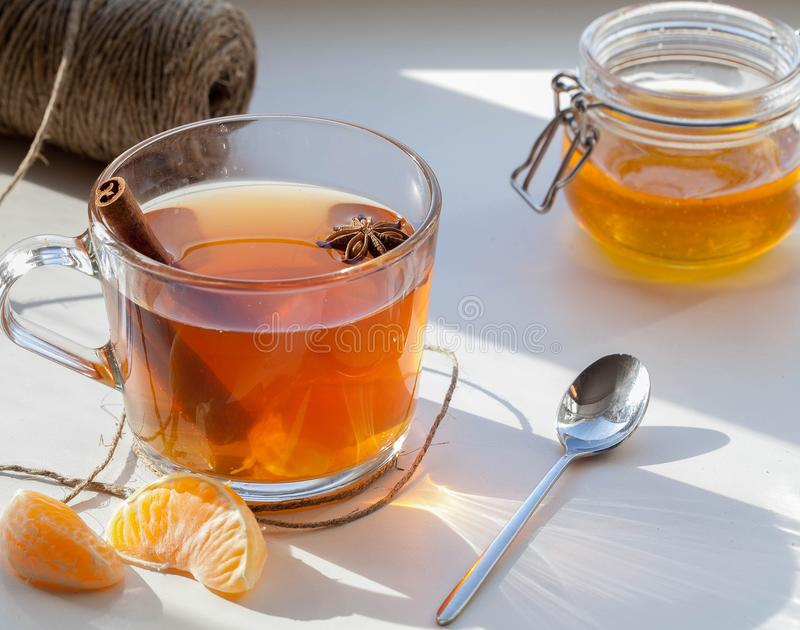 Cup of tea with honey, cinnamon and badyan stock images