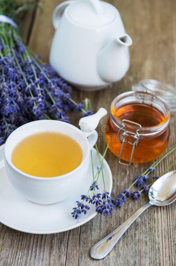 Cup of tea and honey with lavender flowers. On a old wooden table stock photos
