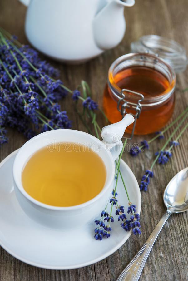 Cup of tea and honey with lavender flowers. On a old wooden table stock photography