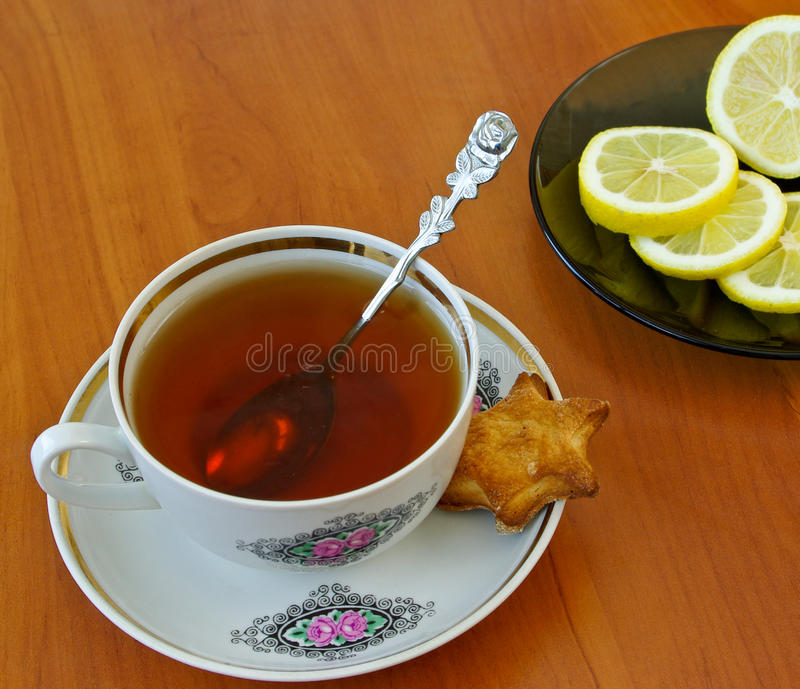 Download Cup of tea and lemon stock photo. Image of full, heat - 13514158
