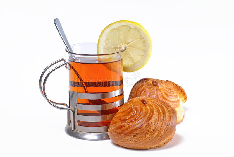 Cup Of Tea With Lemon And Choux Pastry Royalty Free Stock Photos