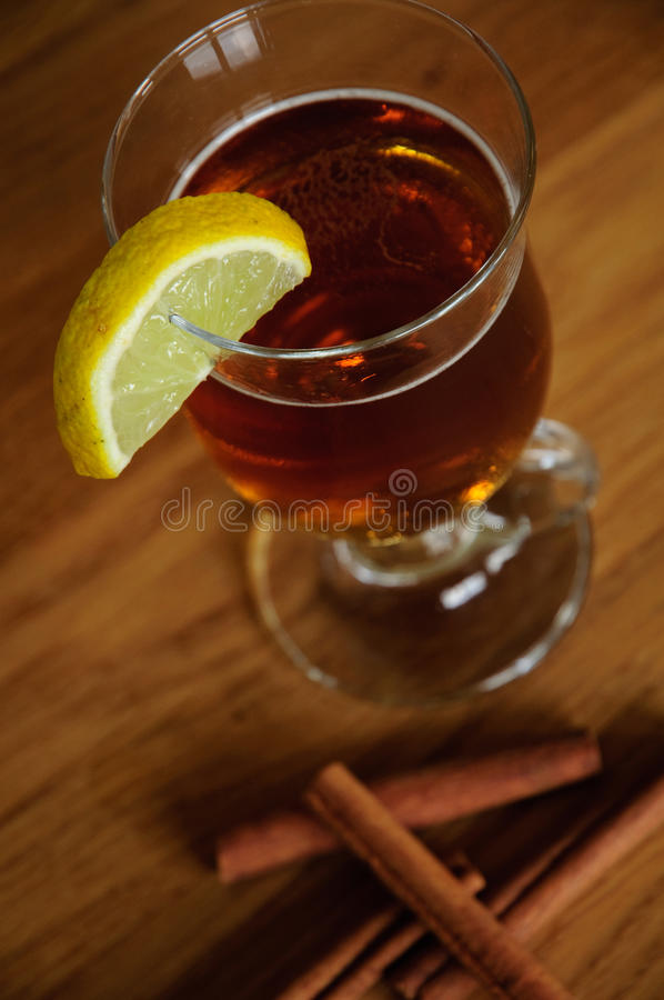 Cup of tea with lemon and cinnamon royalty free stock photos