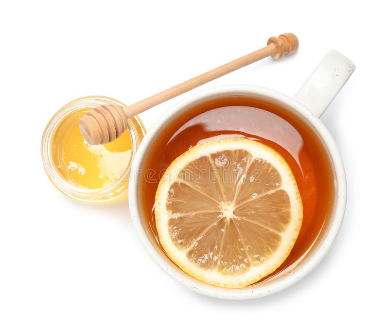 Cup of tea with lemon and honey jar on white background stock images