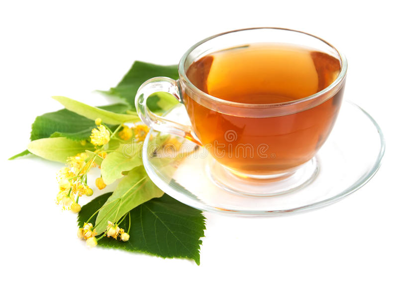 Cup of tea and linden flowers royalty free stock photography