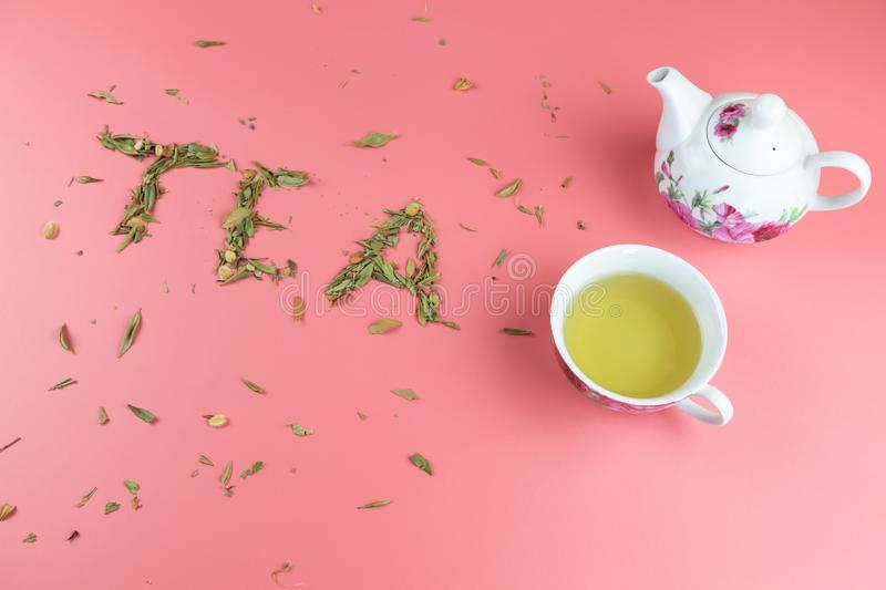 Cup of tea and loose leaf tea stock images