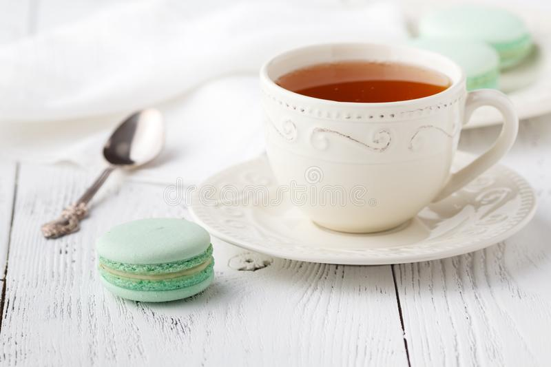 Cup of tea and Macaroons on vintage pastel background stock photos