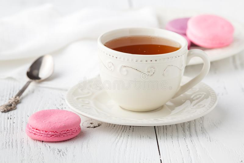 Cup of tea and Macaroons on vintage pastel background stock photography
