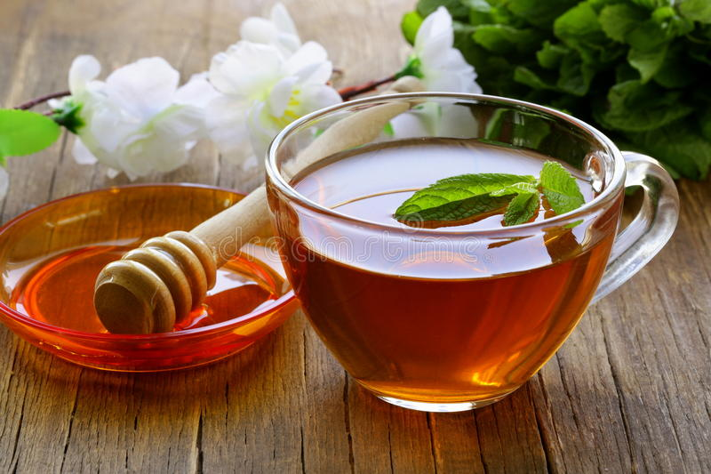 Cup of tea with mint and honey royalty free stock photography