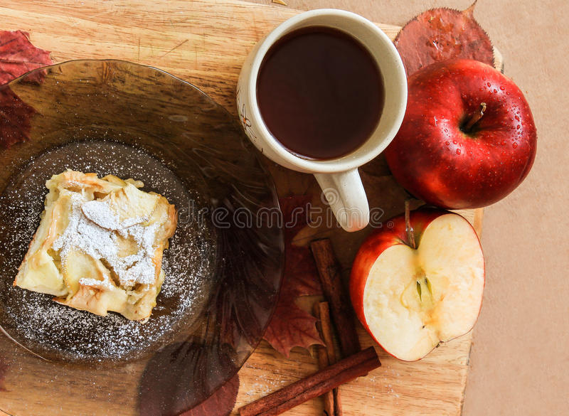 cup of tea and a piece of apple pie on a plate stock photo