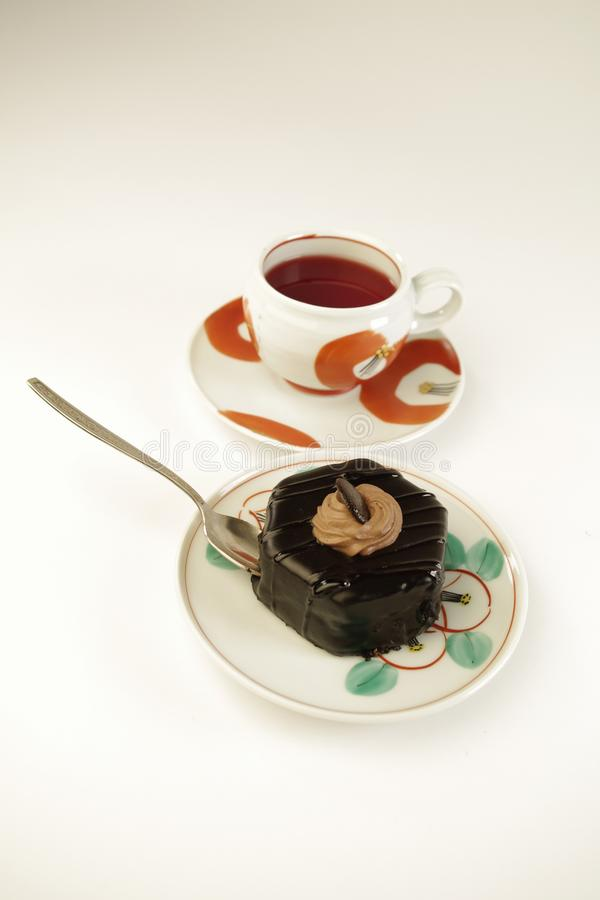 Cup of tea and piece of cake stock images
