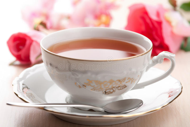 Cup of tea and roses. Elegant cup of tea and roses royalty free stock photos