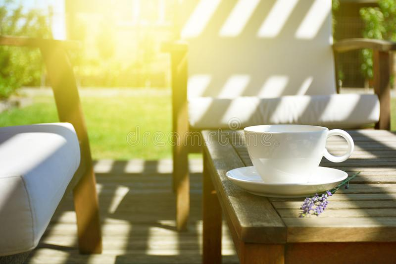 Cup of tea served on natural wood table in the provence style ba royalty free stock images